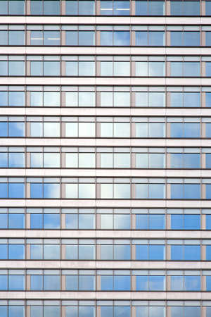 facade of office building with windows reflecting white cloud Stock Photo - 17935772