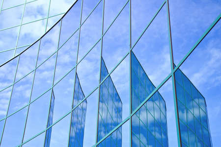 mirrored: five reflections of facade with blue sky and clouds