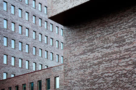 brick walls of office building and sky reflected in windows Stock Photo - 19010275