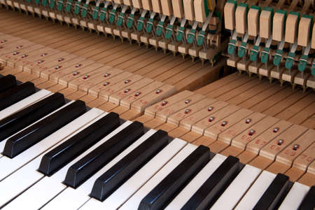 classical mechanics: keys and mechanics in the inner side of a piano Stock Photo