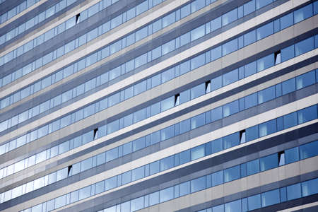 diagonal lines: modern facade with diagonal lines reflecting sky Stock Photo