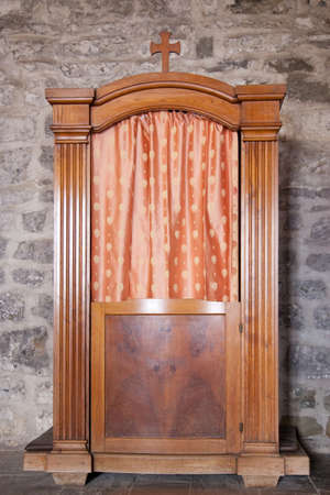 confessional in old church in the italian village of Vernazza in cinque terre photo