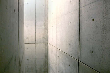 space enclosed by walls made of concrete photo