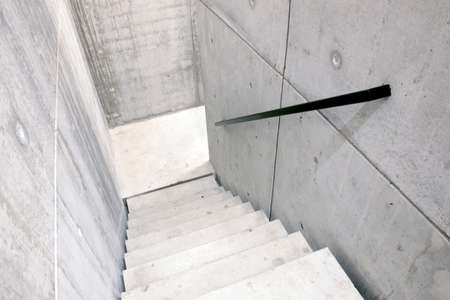 concrete staircase of parking garage and stairs leading down photo