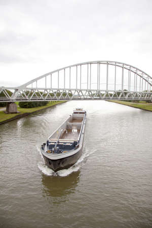 empty transport ship in canal in holland