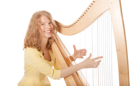 girl in yellow playing the harp against white background photo