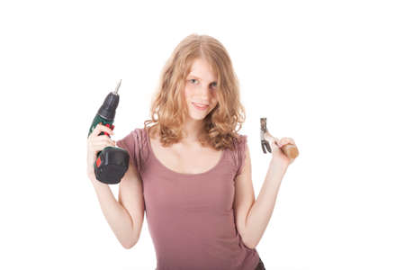 young woman with hammer and drill against white background Stock Photo
