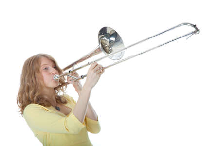 young woman in yellow with trombone against white background photo
