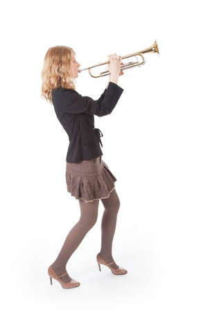 smartly: young smartly dressed woman playing the trumpet against white background