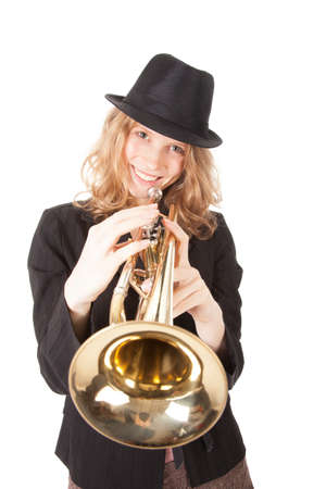 smiling girl with trumpet and black hat against white background
