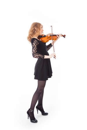 woman violin: young woman in black dress playing violin against white background Stock Photo