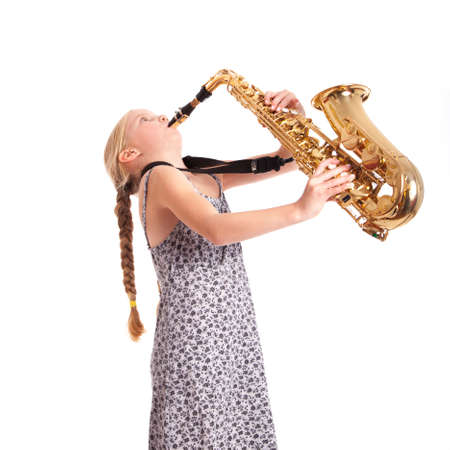 young girl in dress and her saxophone in studio against white background