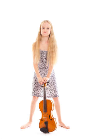 young girl in dress and her violin in studio against white background photo