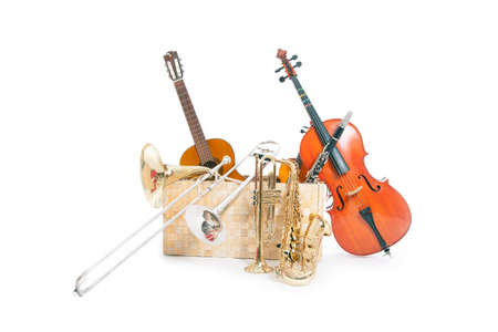 a lot of musical instruments in a box against white background