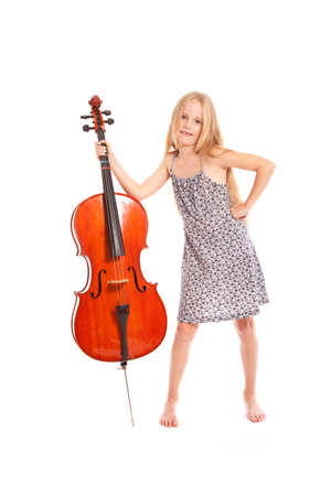 young girl in dress and her cello standing in studio against white background