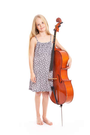 young girl in dress and her cello in studio against white background photo