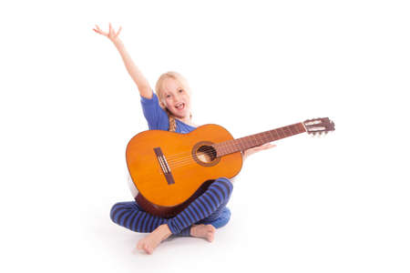 young happy girl with guitar against white background Stock Photo