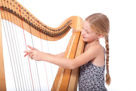 young girl in blue playing harp against white backgound Stock Photo