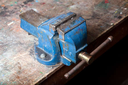 old blue battered bench vice