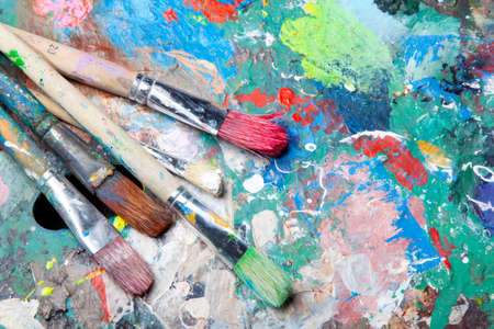 colorful palette and paint brushes photo