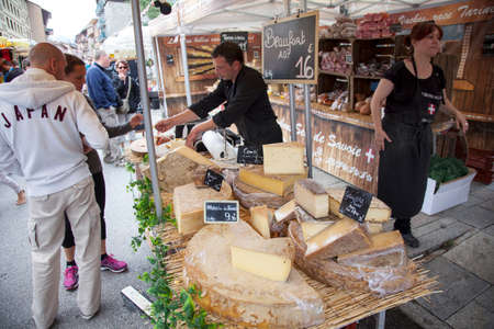 BOURG SAINT MAURICE, FRANCE, 26 JULY 2014: cheese on a french market of Bourg st Maurice in haute savoie