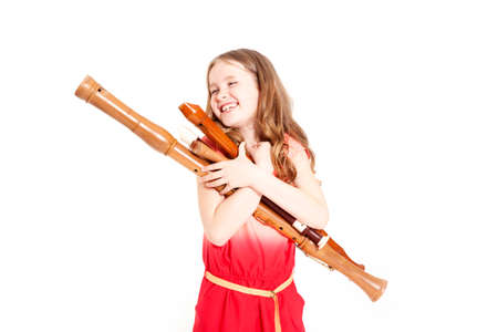 young girl with recorders and white background