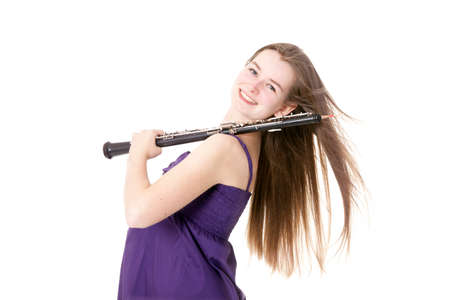 girl in purple dress with oboe against white background photo
