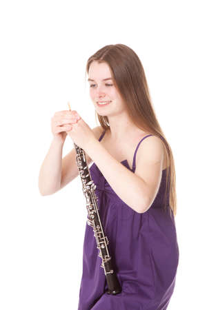 oboe: girl in purple dress with oboe against white background