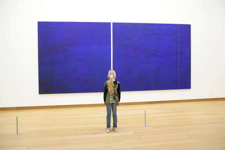 young girl in Stedelijk museum before painring Cathedra by Barnett Newman Editorial