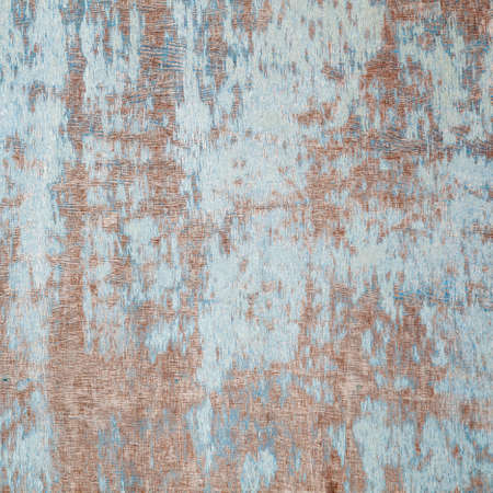 abstract background consisting of weathered board with old blue paint photo