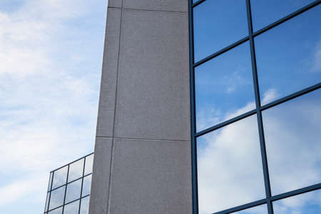new construction: facade of office building with very blue sky and clouds