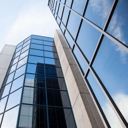 office building and reflections of clouds in blue sky