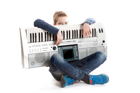 teenage boy with keyboard in studio against white background