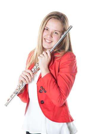 teenage blonde girl holds flute in studio with white background Standard-Bild