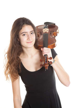 teenage girl and violin in studio with white background Stock Photo