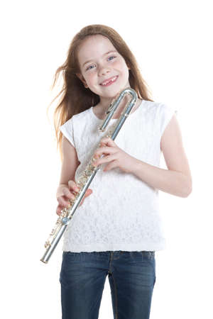 youn girl with brown hair and holding flute in studio with white background