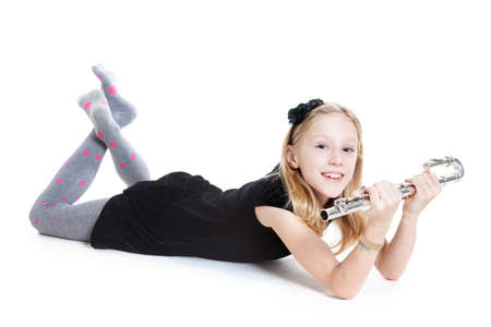 young blond girl holding flute in studio against white background Stock Photo