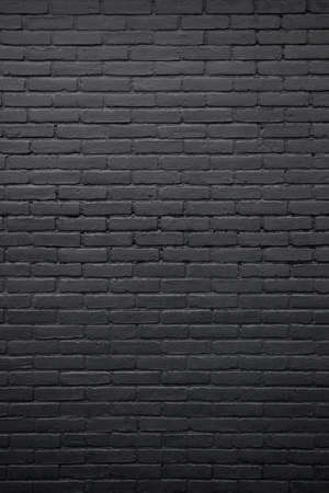 brick background: vertical part of black painted brick wall