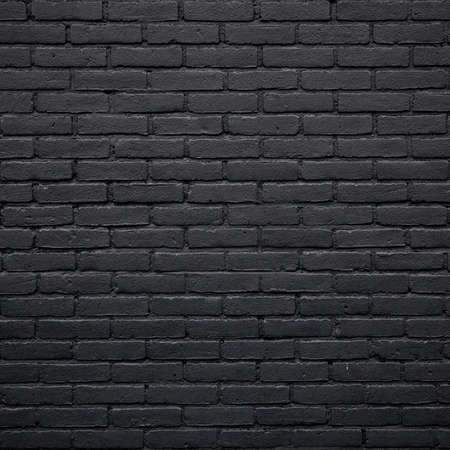 square part of black painted brick wall