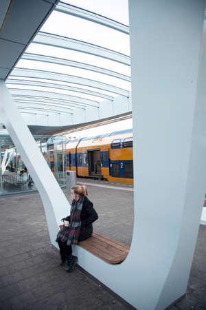 dutch girl: girl waiting on platform of new railway station in the dutch town Arnhem