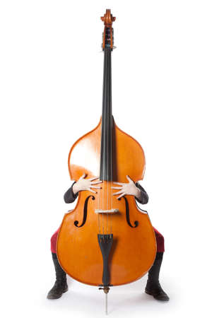 double bass with hands and feet in studio against white background Stock Photo