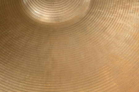 cymbals: closeup of gold colored cymbal on horizontal picture