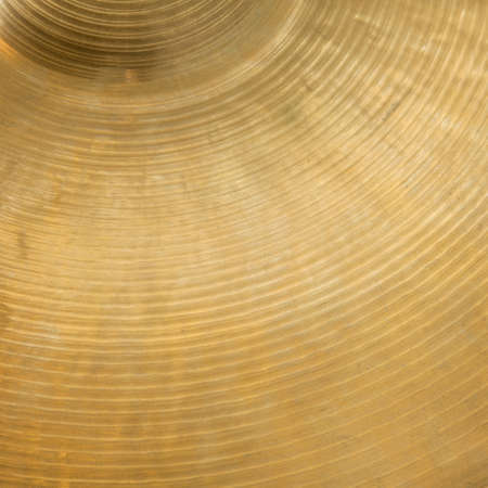 cymbal: closeup of gold colored cymbal on square picture