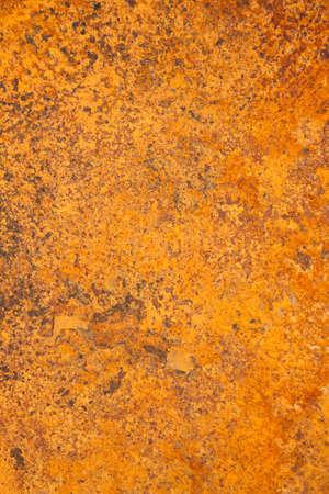 corroding: Vertical image of orange rusty steel
