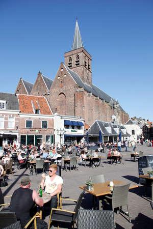 nederland: People enjoy the spring sunshine in the old city of amersfoort Editorial