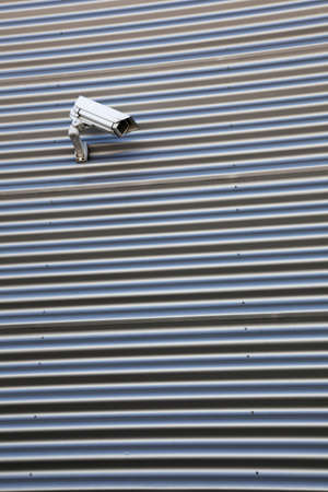 spy camera: Spy camera on corrugated iron building