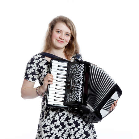 teenage girl in studio with accordion against white background