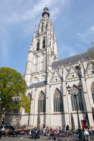 breda: people enjoy the spring sun near breda cathedral in the netherlands