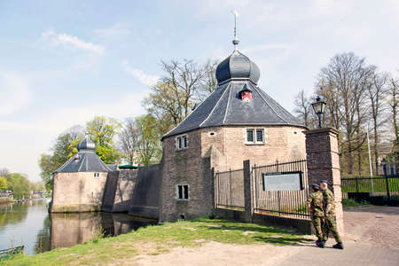 academie: two soldiers in front of old defense buildings near military academy in Breda Editorial