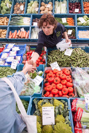breda: customer for fruit and vegetables on market in the dutch city of Breda